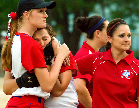 St. Anthony's Abbie Schmidt (left) consoles senior Maddie Schuette as does head coach Crystal Tipton following St. Anthony's 2-0 loss to Raymond Lincolnwood in the Class 1A Altamont Sectional.