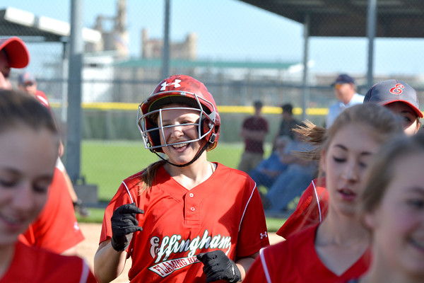 Effingham's Carsyn Fearday (center) smiles as she heads back to the bench after hitting a solo home run against St. Anthony during the City Series.