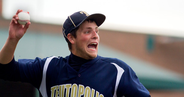 Teutopolis' Austin Johnson eyes first base after fielding a bunt Monday evening in Sauget during the Super-Sectional against Murphysboro.