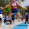 Newton's McKendra Barthelme flies through the air during the triple jump. She would finish ninth with a jump of 35-09. It marked the second of four individual medals on the day for the senior.