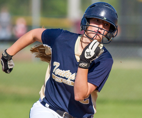Teutopolis' Danielle Repking rounds second base in Flora against Robinson. The senior not only had a big night behind the plate as the catcher but also at the plate, going 2-for-3 with three RBI.