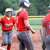 Effingham's Jenna Wright (left) rounds third and heads home to a waiting crowd of teammates after hitting a home run in game one of the City Series against St. Anthony.<br /> Chet Piotrowski Jr./Piotrowski Studios