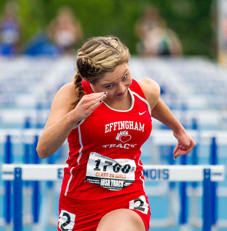 Effingham junior Camryn Heuerman sprints hard to finish the 100-meter high hurdles during the Class 2A state track preliminary meet in Charleston. She finished with a time of 16.83.