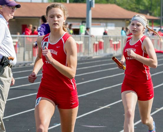 Effingham's Shayna Phillips gets out ahead of her teammate Meredith Kull during the 4x800-meter relay at the Apollo Conference meet in Charleston. Phillips went on to later win the 800-meter run and take second in the 400-meter dash.