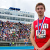 Effingham's Sean Zerrusen stands in front of the O'Brien Stadium grandstand at Eastern Illinois University with his gold medal after winning the Class 2A 800-meter run with a personal best of 1:55.38.