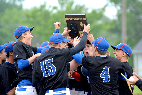 The Newton Eagles celebrate with the Class 2A Newton Regional championship plaque after defeating Carlyle 8-4.