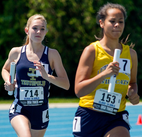 Teutopolis' Kara Weichman (left) runs the anchor of the 4x800 relay at the Class 1A state track preliminary meet. The relay finished eighth in its heat with a time of 10:38.06.