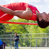Effingham's Terrence Hill is seen clearing the bar during the high jump. Hill won the event with a jump of 06-03.