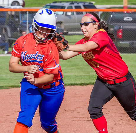 Newton's Montana Ochs tries to evade a tag in a rundown from Charleston's Jenna Durham.