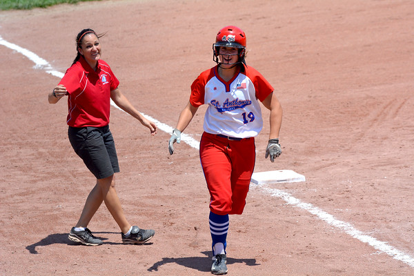 St. Anthony's Hunter Niebrugge rounds third base past coach Crystal Tipton after hitting a home run in the seventh inning of the Class 1A St. Anthony Regional title game against Windsor/Stew-Stras. It was the 25th homer of Niebrugge's career, setting a school home run record.