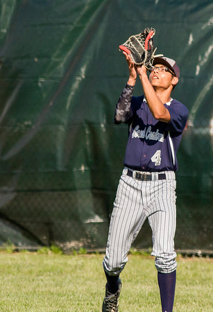 South Central senior Dre Hill eyes a fly ball to center field in Louisville at the Class 1A North Clay Sectional.