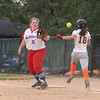 St. Anthony first baseman Allie Day awaits a throw from Jenna Woltman, not pictured, to retire Raymond Lincolnwood's Taylor Pope at the Class 1A Altamont Sectional.<br /> Chet Piotrowski Jr./Piotrowski Studios