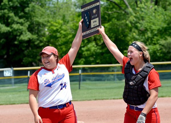 St. Anthony's Maddie Schuette (left)  and Hunter Niebrugge (right) lift the Class 1A St. Anthony Regional plaque after defeating Windsor/Stew-Stras.