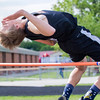 Altamont's Mitchell Stevenson clears the pole during the high jump. He finished second with a jump of 06-00.