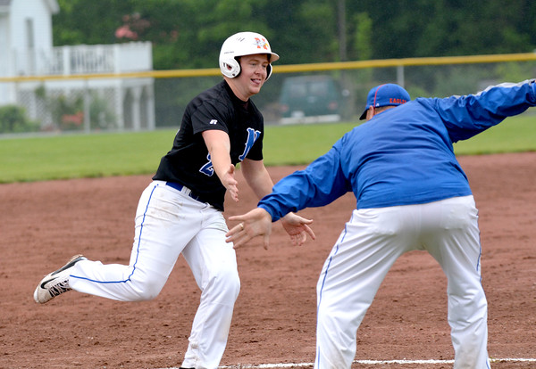 Newton's Beau Prater rounds third base and reaches for a high five from coach Jason Fulton after hitting a three-run home run in the Class 2A Newton Regional championship game, an 8-4 win for Newton.