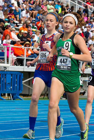 Newton freshman Sarah Carr (left) tries to pass McLeansboro's Leslie Drone during the first section of the 3,200-meter run. Carr finished 22nd with a time of 12:27.10.