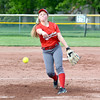 Effingham's Aly Armstrong watches a pitch fly toward a Teutopolis batter at St. Anthony High School.