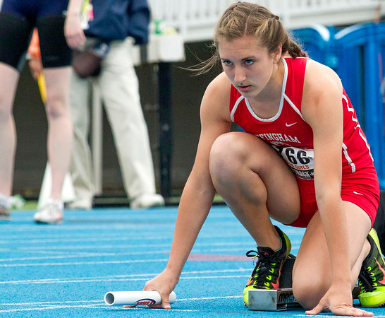 Effingham freshman Miranda Fox eyes the track before beginning the 4x400-meter relay at the Class 2A state track preliminary meet.