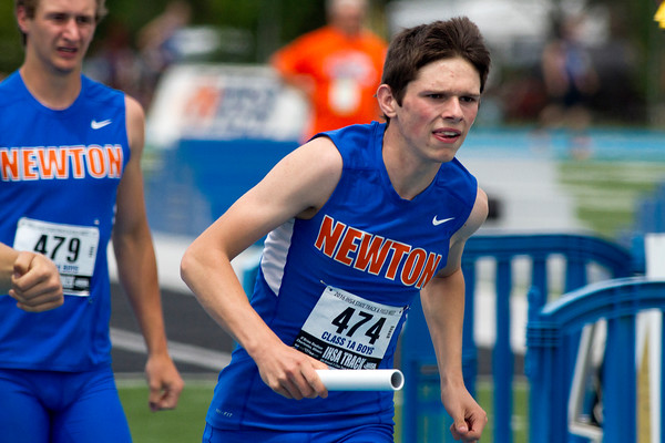 Sophomore Rhett Kocher (center) of Newton takes off after receiving the baton from teammate Tim Weber (left) during the 4x200-meter relay at the Class 1A state track preliminary meet. The team finished sixth in their heat with a time of 1:34.65.