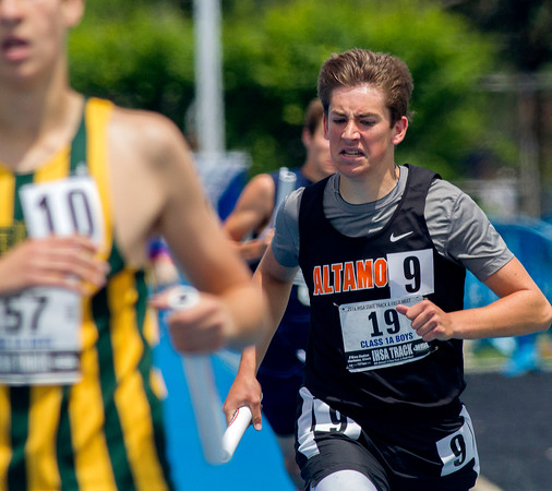 Altamont's Christian Freezeland (right) runs the anchor of the 4x800-meter relay at the Class 1A state track preliminary meet. The team finished sixth in their heat with a time of 8:35.32.