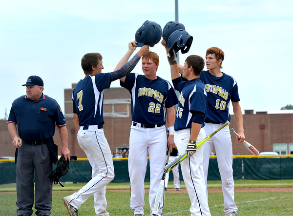 From left, Teutopolis' Brock Bueker is congratulated at home by John Kreke (22), Austin Johnson (15) and Devin Smith (10) after hitting a two-run home run in the third inning of the Class 2A Teutopolis Sectional final. The Wooden Shoes beat Newton 6-3 and advanced to Super-Sectionals.