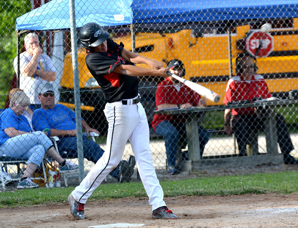 North Clay's Reese Blank lifts an RBI single during the Class 1A North Clay Sectional semifinal against Oblong, a 9-5 win for North Clay.