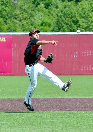 North Clay shortstop Michael Lovett fires a ball across the diamond during the Class 1A SIU Super-Sectional in Carbondale. North Clay lost 12-1 to Goreville and ended its season.