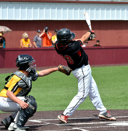 North Clay's Quincy Aldrich hits an RBI triple during the Class 1A SIU Super-Sectional against Goreville.