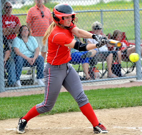Effingham's Alissa Kersey swings through a ball and makes contact during the City Series opener at Effingham High School against St. Anthony.
