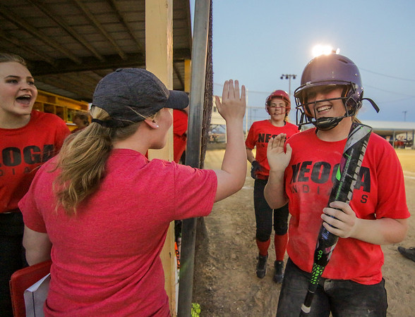 Neoga's Lydia Gentry, right, is greeted by teammates in the dugout in Toledo during the Lady Indians' seventh-inning rally, which propelled them to an 8-3 win over St. Anthony.