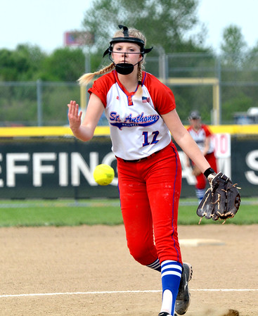 St. Anthony's Jessica Coffin watches her pitch fly toward home plate in the City Series against Effingham.