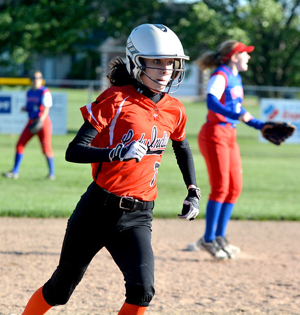 Altamont's Katie Grimsley rounds second base and heads to third during an 18-2 win at the NTC Tournament over Cowden-Herrick/Beecher City at Evergreen Park.