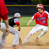 St. Anthony courtesy runner Cade Walsh tries to avoid the tag at third base against Effingham.