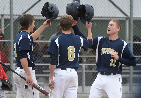 Teutopolis' Lane Belleville (11, right) hits his helmet against Brant Bueker's (3, left) and Jason Kenter's (8, right) in celebration of Belleville's home run in the fourth inning against Effingham.<br /> Chet Piotrowski Jr./Piotrowski Studios