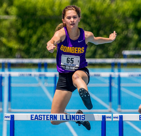 Brownstown/St. Elmo's Claire Wilhour clears a hurdle during the 300-meter low hurdles competition at the IHSA Class 1A State Track Meet Preliminaries in Charleston. Wilhour advanced to the finals with a time of 47.01 seconds.
