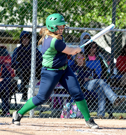 Windsor/Stew-Stras' Taylor Rentfro follows through on her swing when she hit a grand slam in a win over Neoga at the National Trail Conference Tournament at Evergreen Park.