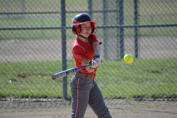 Effingham's Lauryn Douthit swings at an incoming pitch during a win at Mt. Vernon.
