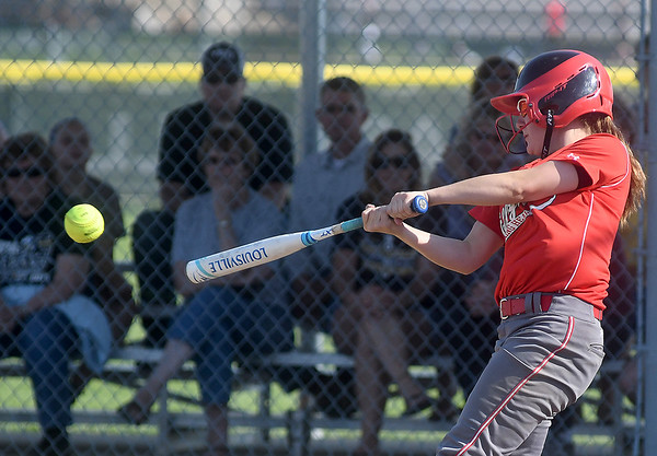 Effingham's Morgan Krouse connects on a pitch during a doubleheader against Teutopolis at Effingham. The Lady Hearts won both games. <br /> Chet Piotrowski Jr./Piotrowski Studios