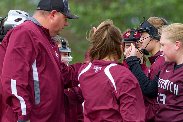 Dieterich head coach Jason Newkirk, left, meets with his team during the National Trail Conference tournament. Newkirk took over as the softball head coach in April after former coach Becky Wilson resigned midseason.