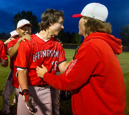 Effingham's Zach Lee, center, celebrates with teammates Noah Spencer, left, and Blake Lohman, right after he walked off with a two-run double to give the Hearts a 6-5 win over Bethalto Civic Memorial.