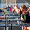 Altamont's Mitchell Stevenson (right) clears a hurdle during the 110-meter hurdles at the National Trail Conference meet. Stevenson won the event in a time of 15.16 seconds. The Indians also finished first overall with 171 points.