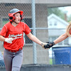 Effingham's Carsyn Fearday gets a five from Aly Armstrong (right) after scoring during game two of the City Series against St. Anthony.