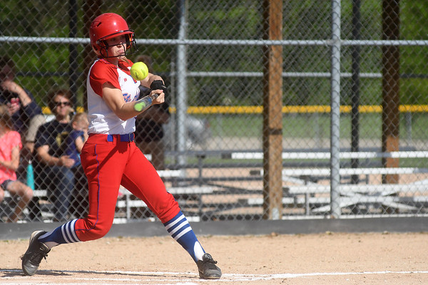 St. Anthony's Katie Kabbes makes contact with a pitch during the fifth annual Cross Creek Classic. Teutopolis won the first four meetings but the Bulldogs got their first win with a 4-1 victory.<br /> Chet Piotrowski Jr./Piotrowski Studios