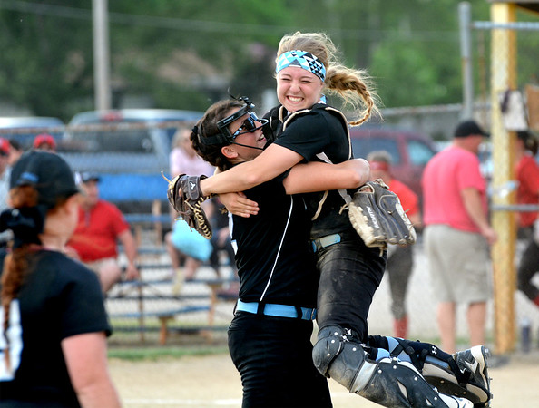 Cumberland catcher Claire Guyon (right) jumps into the arms of pitcher Liberty Dunaway (left) moments after the final out of the Class 1A Cumberland Regional title game, a 6-3 win by the Lady Pirates over Neoga.