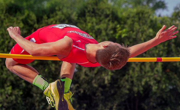 Effingham's Kody Line tries to clear the high jump at 6-feet, 1-inch in his basketball shoes after a last-second issue arose with his spikes.