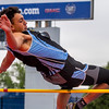 Cumberland's Tyson Magee clears the bar at 5-11 during the high jump at the IHSA Class 1A State Track and Field Preliminaries in Charleston.
