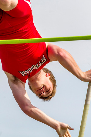 Effingham's Alec Morrissey clears the bar at 13 feet, 6 inches during the pole vault event at the Apollo Conference track meet in Mattoon. Morrissey finished second.
