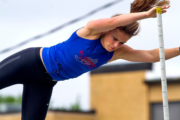 St. Anthony senior Kristin Slaughter clears the bar during the pole vault at the Newton Sectional.