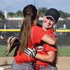 Effingham's Jenna Wright hugs teammate Aly Armstrong after the final out during the Class 3A Effingham Regional championship game . Effingham beat Charleston 2-0.<br /> Chet Piotrowski Jr./Piotrowski Studios