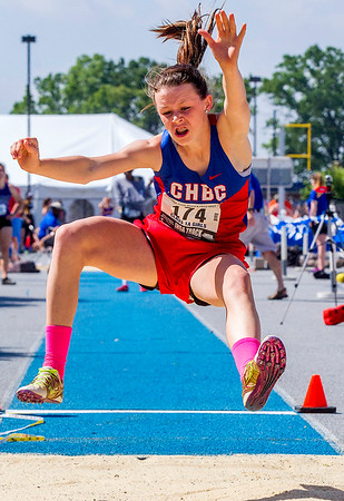 Cowden-Herrick/Beecher City's Jaelyn Robertson goes airborne during the triple jump at the IHSA Class 1A State Track Meet Preliminaries in Charleston.